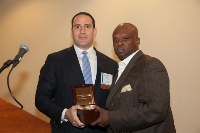 PSG President Aaron Green accepts a NEHRA Award of Excellence from Greg Almeida of Global View Communications. Photo courtesy of David Fox Photography